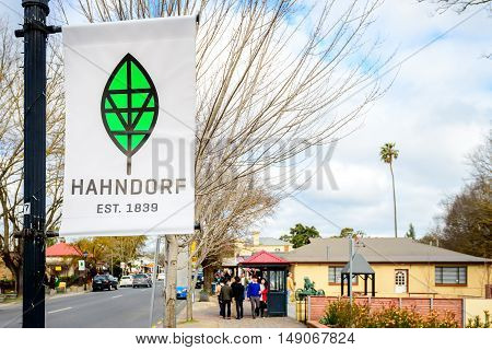 Adelaide Australia - August 13 2016: Banner of Hahndorf with the main street view with people walking in the background South Australia.