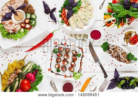 Served banquet in russian tradition, flat lay. Variety of traditional snacks for vodka. Menu, tableful, buffet, party concept