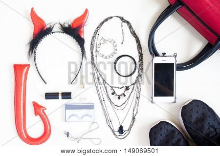 Flat lay photography with Halloween fashion accessories cosmetics essential items for woman Overhead view of Halloween accessories items top view