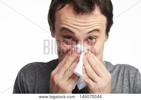 Man Blowing His Nose Hard