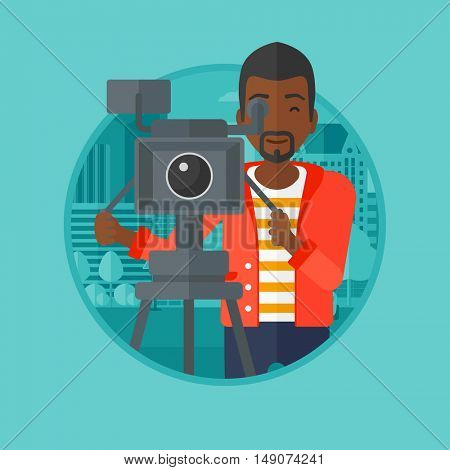An african-american cameraman looking through movie camera on a tripod. Young man with professional video camera in the city. Vector flat design illustration in the circle isolated on background.