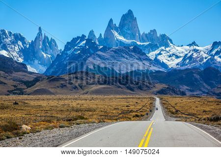 Fine concrete highway to the majestic Mount Fitz Roy. Sunny autumn day in February. Argentine Patagonia