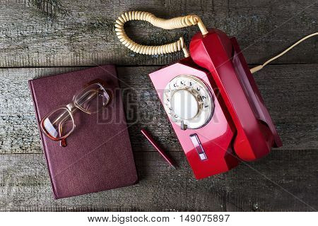 Vintage Red Phone, Old Glasses And Notebook