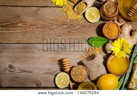 honeycombs honey ginger pollen lemon on a wooden table
