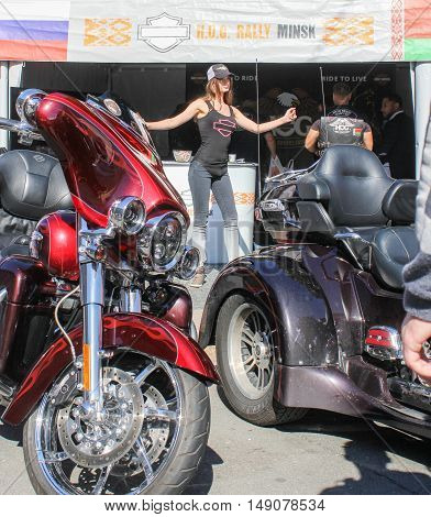 St. Petersburg, Russia - 12 August, Girl between motorcycles,12 August, 2016. The annual International Festival of Motor Harley Davidson in St. Petersburg Ostrovsky Square.