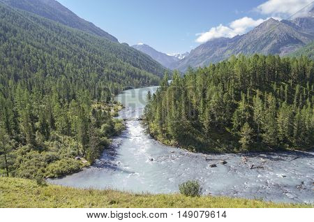 The Kucherla river flows from Kucherla lake. Altai Mountains Russia. Sunny summer day.