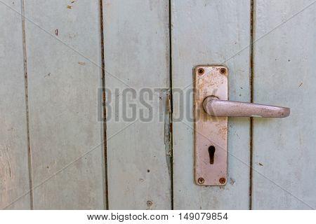 Old door handles on wood house door