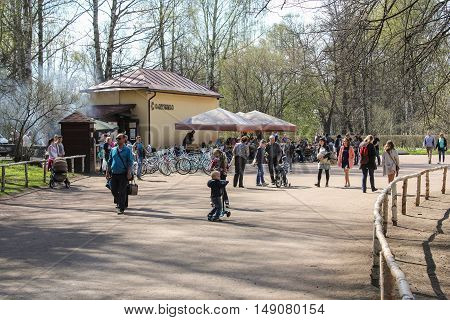 St. Petersburg, Russia - 3 May, Bicycle rental at the cafe Slavyanka,3 May, 2016. People and spring landscape in Pavlovsk park.