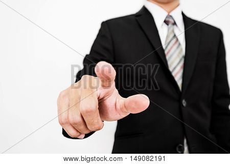Businessman touching a touchscreen, on white background, selective focus