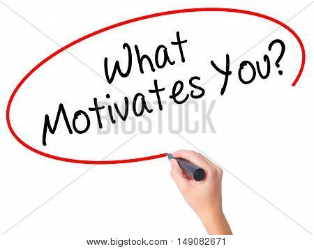 Women Hand Writing What Motivates You? With Black Marker On Visual Screen