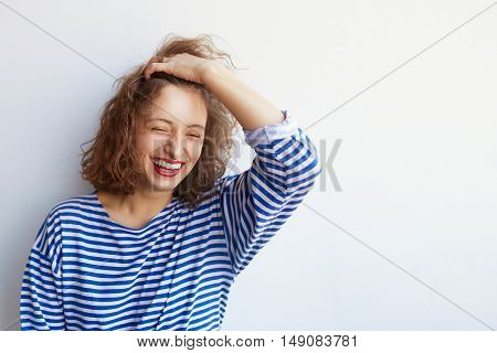 Fashion lifestyle portrait of young happy pretty woman laughing and having fun in stylish vintage outfit on white bacground with copy space