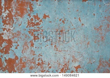 Plastered wall with peeling paint in red biue and pink colors