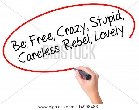 Women Hand Writing Be: Free, Crazy, Stupid, Careless, Rebel, Lovely With Black Marker On Visual Scre