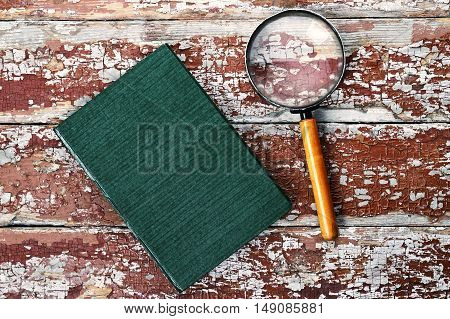 Magnifying Glass Or Loupe With Book