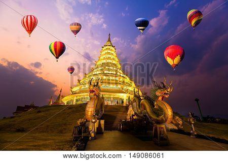 Hot-air balloons flying over Wat hyua pla kang Chiang Rai Thailand
