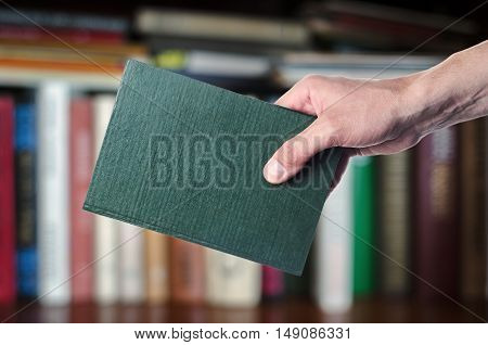 The Book In The Hands