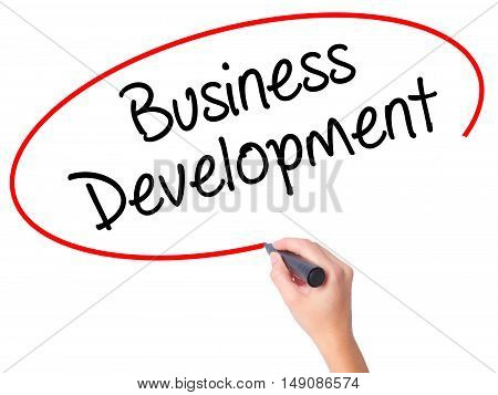 Women Hand Writing Business Development With Black Marker On Visual Screen.