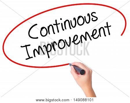 Women Hand Writing Continuous Improvement With Black Marker On Visual Screen