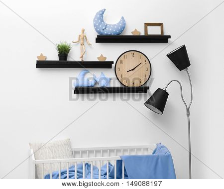 Shelves with small bed in modern baby room
