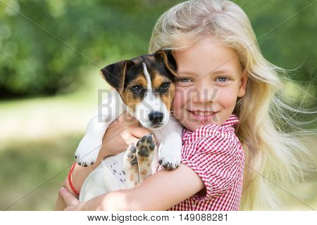 Outdoor Portrait Of Girl Holding Pet Dog