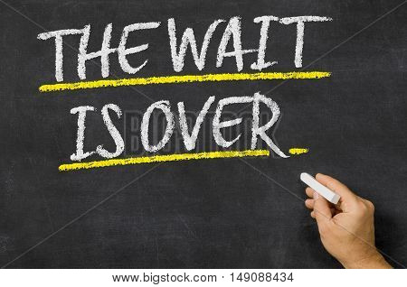 The Wait Is Over Written On A Blackboard