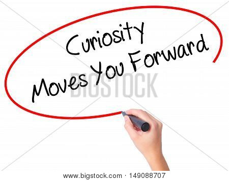 Women Hand Writing Curiosity Moves You Forward With Black Marker On Visual Screen