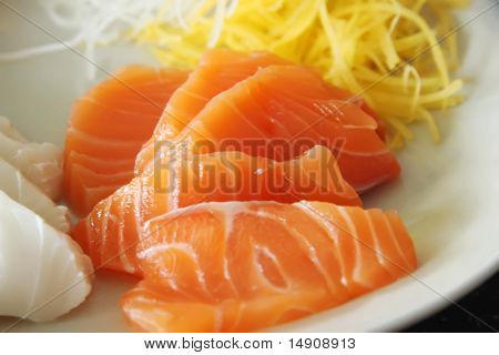 Arrangement of sashimi sliced raw japanese fish dish