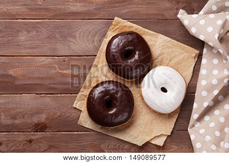 Donuts on wooden table. Top view with copy space