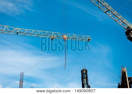 Building construction site at sunny day, blue cloudy sky