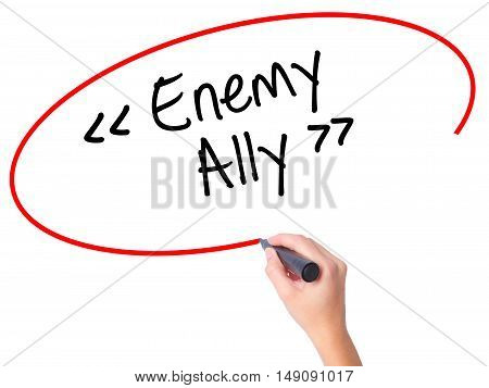 Women Hand Writing Enemy - Ally With Black Marker On Visual Screen.