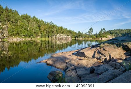 Green forest and stone shores. Beautiful nature of Karelia.