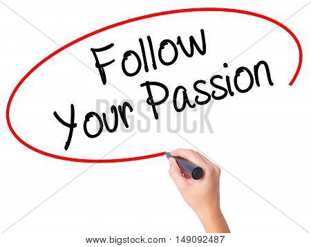 Women Hand Writing  Follow Your Passion With Black Marker On Visual Screen