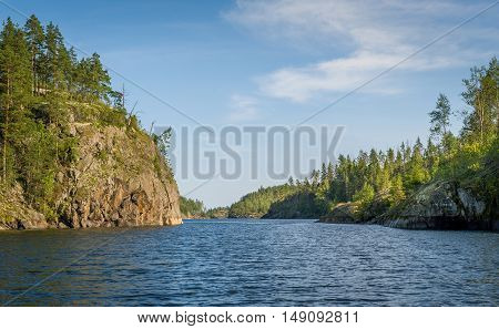 High rocky island shores and water of Ladoga lake. Karelia republic, popular backpacking tourism spot, Russia.