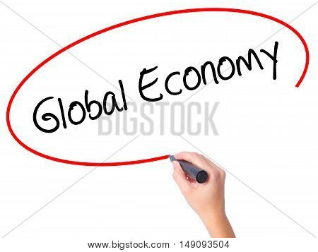 Women Hand Writing Global Economy With Black Marker On Visual Screen