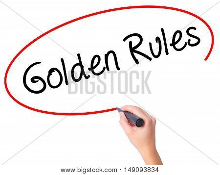 Women Hand Writing Golden Rules With Black Marker On Visual Screen