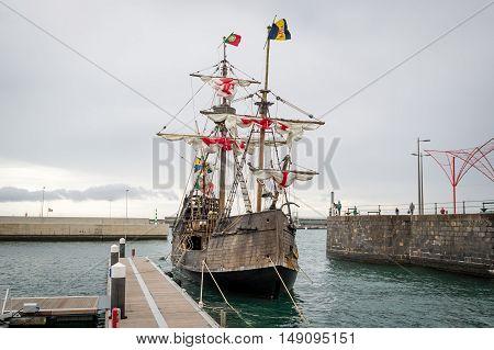Christopher Columbus flagship Santa Maria historical ship replica at Funchal harbor. Madeira island, Portugal.