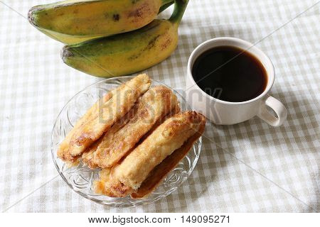 Banana fritters and coffee on served on table