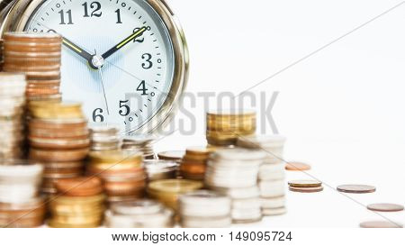 Alarm Clock And Money,coins Stack And Alarm Clock On Background,finance Concept,business Background