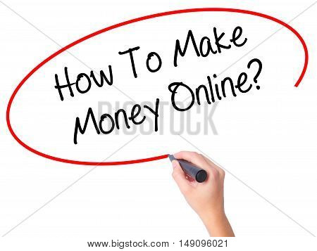 Women Hand Writing How To Make Money Online? With Black Marker On Visual Screen