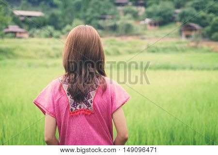 Woman traveler looking green rice terraces field in Chiangmai Thailand Vintage tone