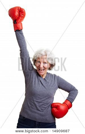 Senior Woman Cheering With Boxing Gloves