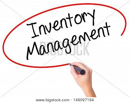 Women Hand Writing Inventory Management With Black Marker On Visual Screen.