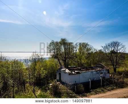 The dilapidated building on the background of the Gulf of Finland in the fort
