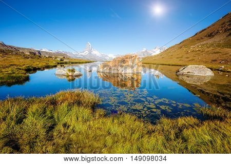 Great  panorama with famous peak Matterhorn in alpine valley. Popular tourist attraction. Dramatic and picturesque scene. Location place Swiss alps, Stellisee, Valais region, Europe. Beauty world.