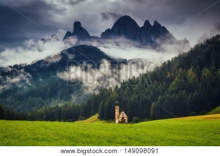 View of the San Giovanni church in Funes valley. National park Puez Odle (Geisler). Dolomites, South Tyrol. Location Bolzano, Santa Magdalena, Italy alps, Europe. Dramatic scene. Beauty world.
