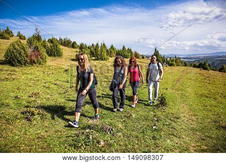 UVAC, SERBIA-SEP 17, 2016: Group of people with backpacks hiking at meanders of the river Uvac on Sep 17, 2016, southwest Serbia.