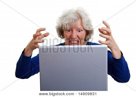 Frustrated Elderly Woman With Laptop