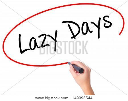 Women Hand Writing Lazy Days With Black Marker On Visual Screen.