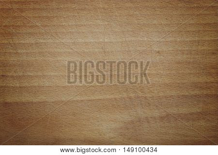 Old wooden cutting board background texture with dark corners