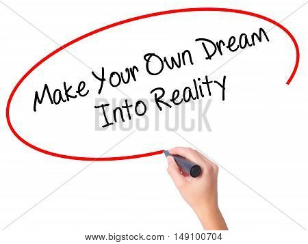 Women Hand Writing Make Your Own Dream Into Reality With Black Marker On Visual Screen